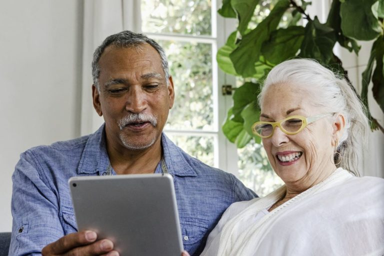 Belleview Suites at DTC   Seniors reading information on tablet