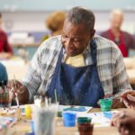 Belleview Suites at DTC | Senior man in art class