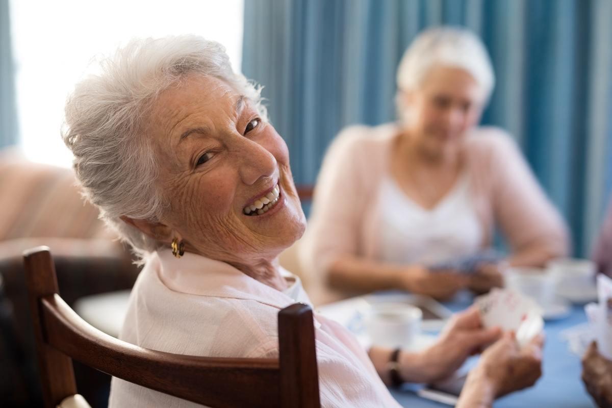 Broadway Mesa Village   Seniors playing card game