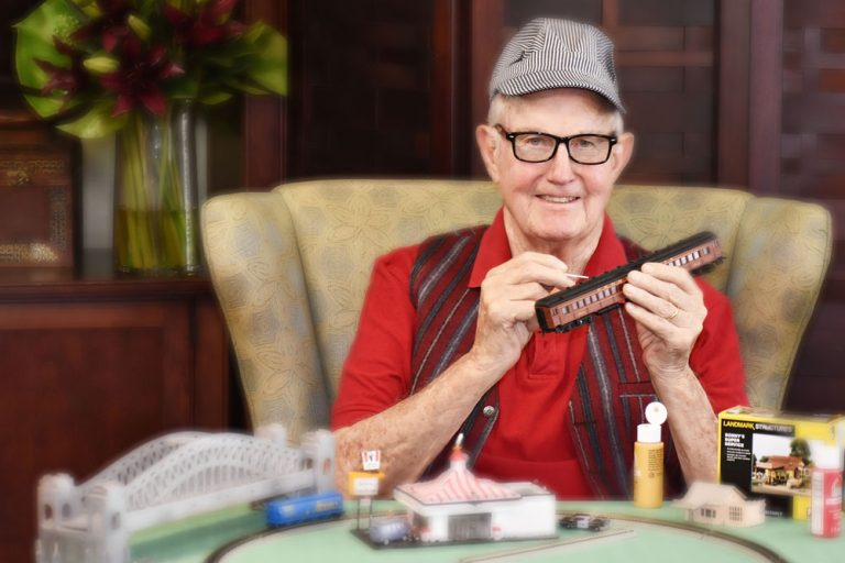 Broadway Mesa Village | Smiling senior man crafting