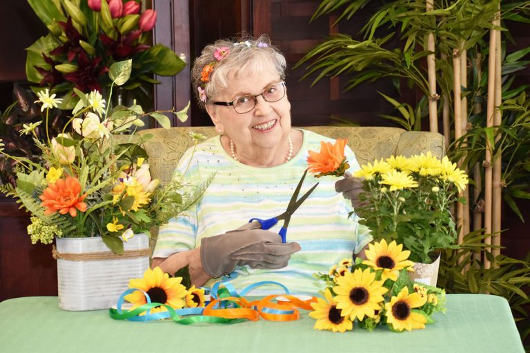 Broadway Mesa Village | Senior woman creating floral crafts