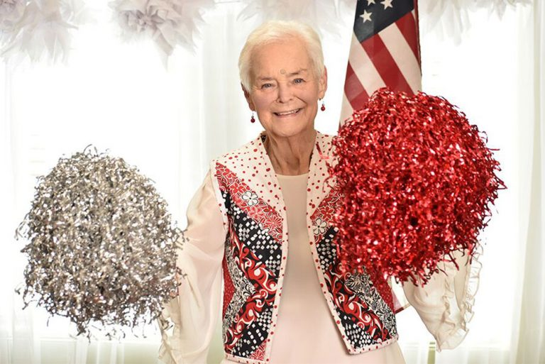 Broadway Mesa Village | Senior woman with pom-poms
