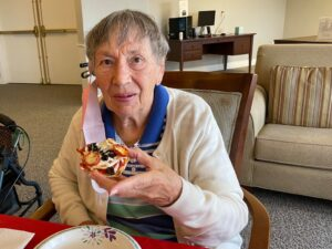 Pegasus Senior Living   Senior woman eating pizza