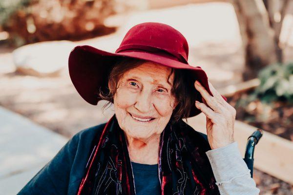 Broadway Mesa Village | Senior woman in hat smiling