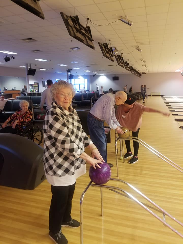Castlewoods Place | Resident bowling during outing