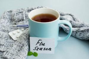 Pegasus Senior Living   Mug of tea next to a card that reads flu season