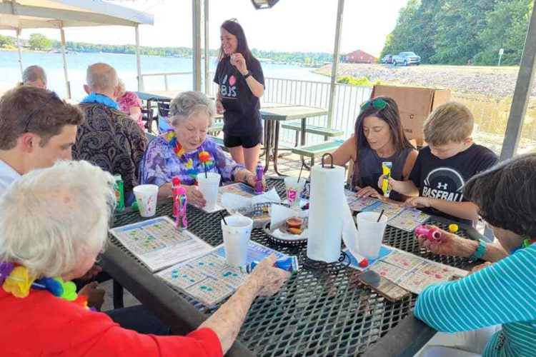 Castlewoods Place | Seniors and their family members playing bingo