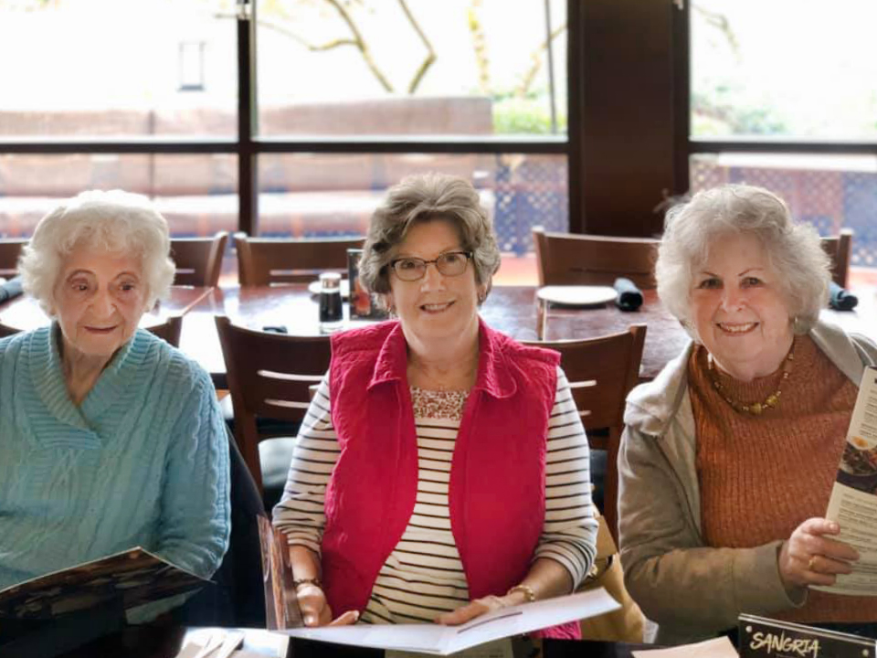 Dunwoody Place | Group of residents ordering from restaurant menu