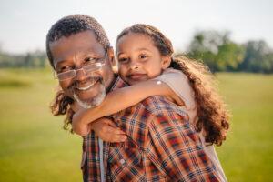 Dunwoody Place | Senior giving granddaughter a piggyback ride