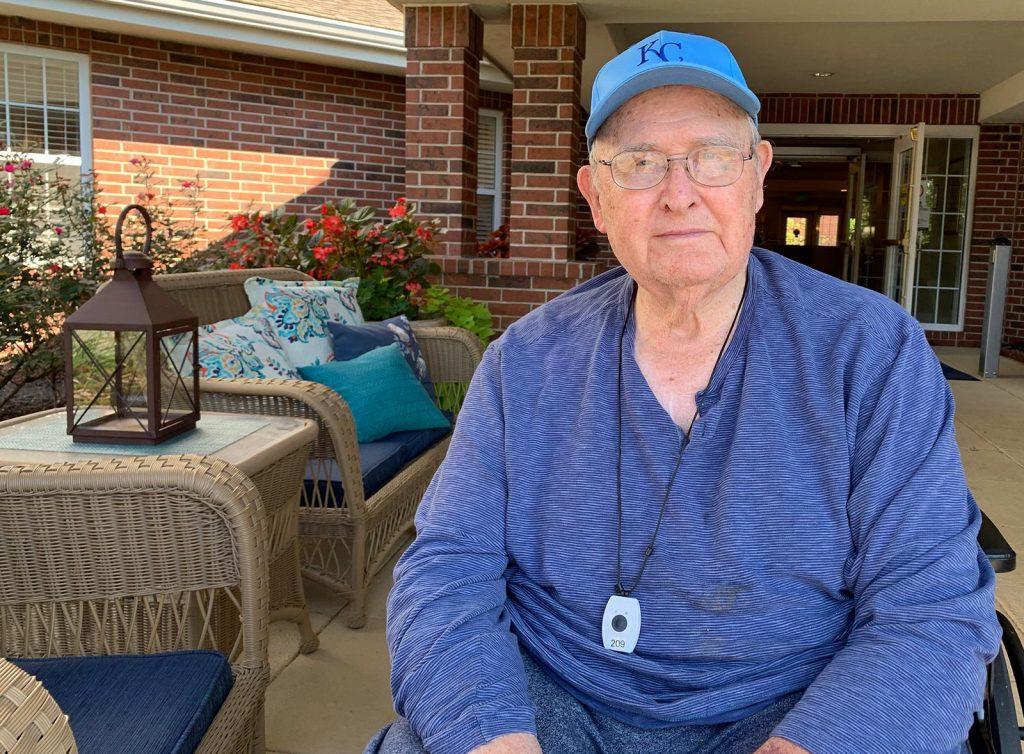 Glenwood Village of Overland Park | Senior man sitting on porch