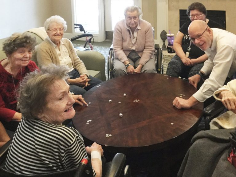 Glenwood Village of Overland Park | Group of seniors playing game