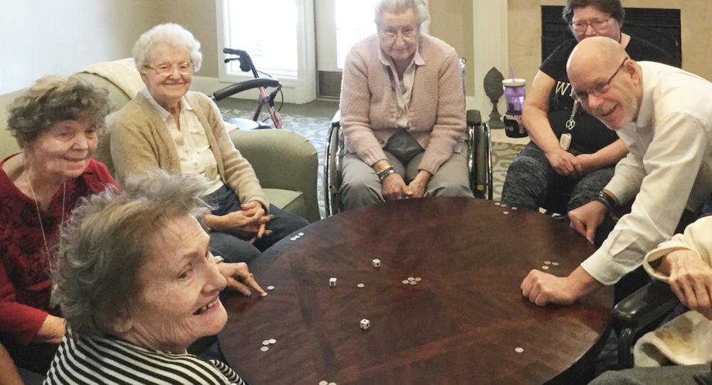 Glenwood Village of Overland Park | Group of seniors playing game