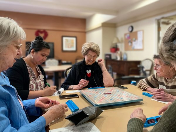 Greenhaven Place | Seniors playing Scrabble