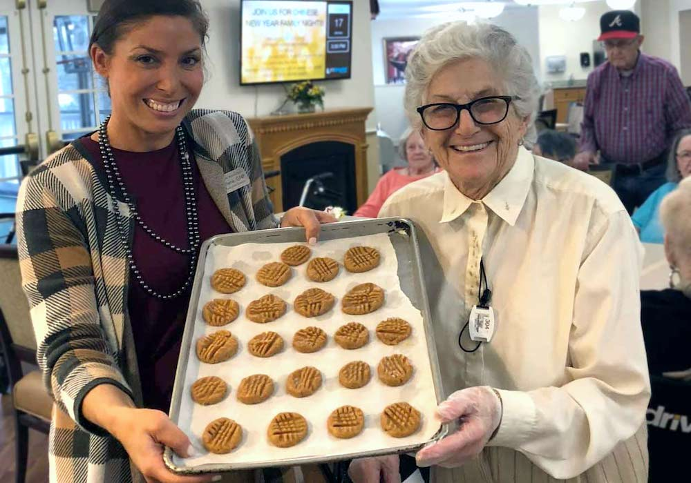 Historic Roswell Place | Senior woman baking with associate