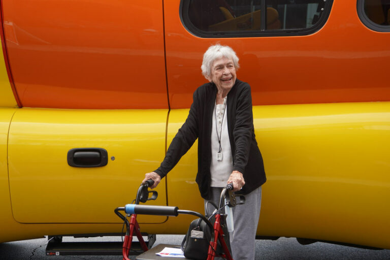 Historic Roswell Place | Senior woman in front of Oscar Mayer Weinermobile