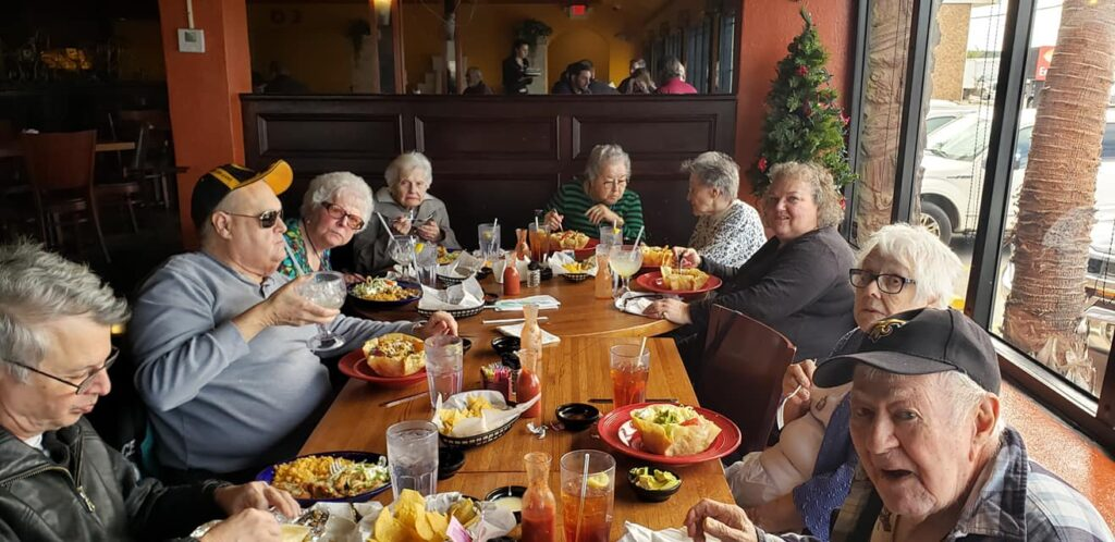 Laketown Village | Seniors dining during outing