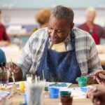 Laketown Village | Senior man in art class