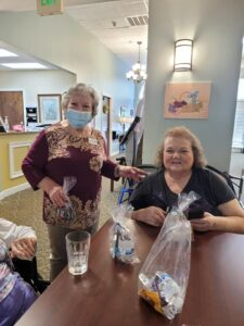 Laketown Village | Residents smiling with goodie bags full of snacks