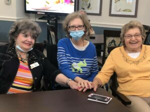 Laketown Village | Three residents holding hands