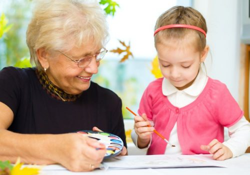 Laketown Village | Senior woman drawing with young girl