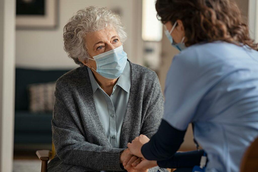Lakeview of Kirkland | Associate comforting senior in mask