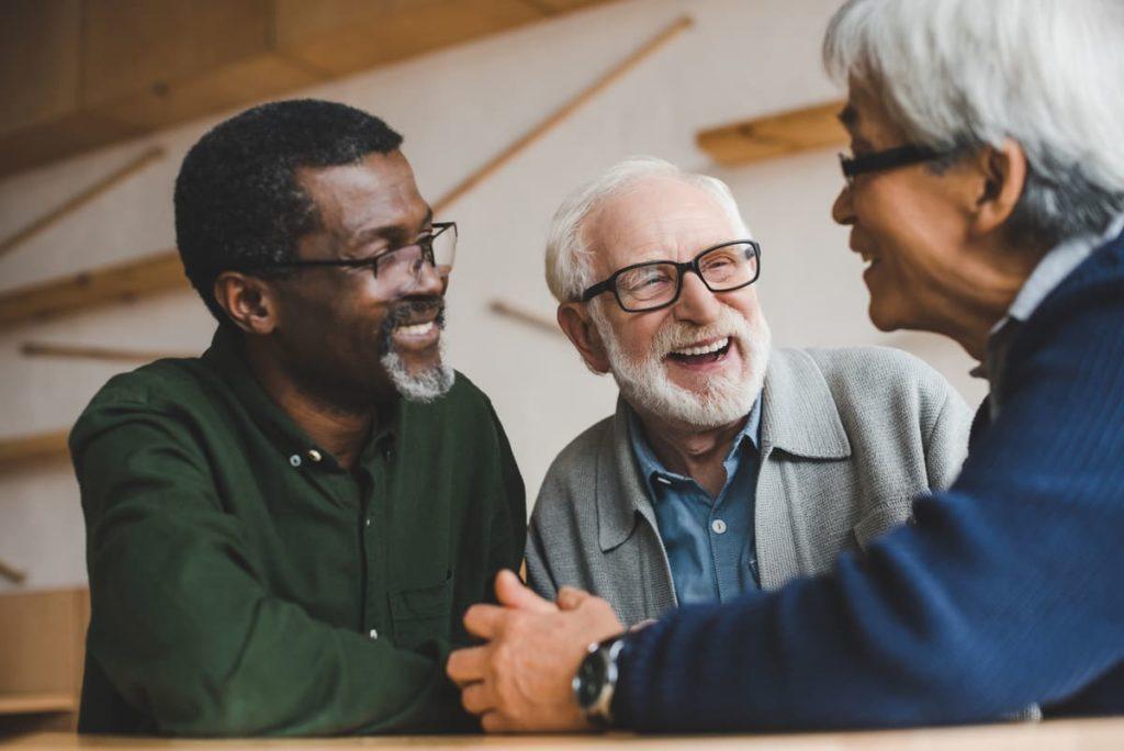 Magnolia Place of Roswell | Seniors in kitchenHappy group of senior men
