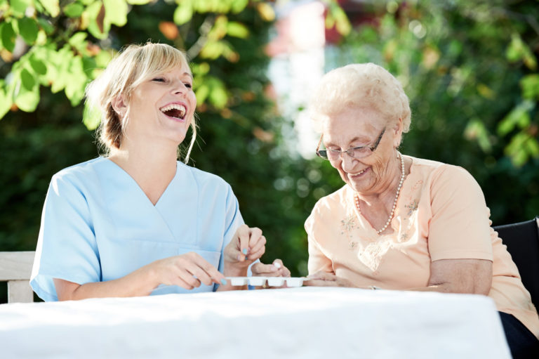 Magnolia Place of Roswell | Senior laughing with caregiver