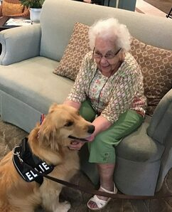 Magnolia Place of Roswell | Resident with therapy dog