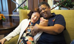 senior living director embracing senior living resident