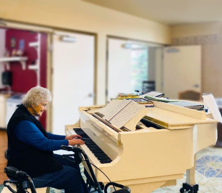 North Point Village | Senior woman playing the piano