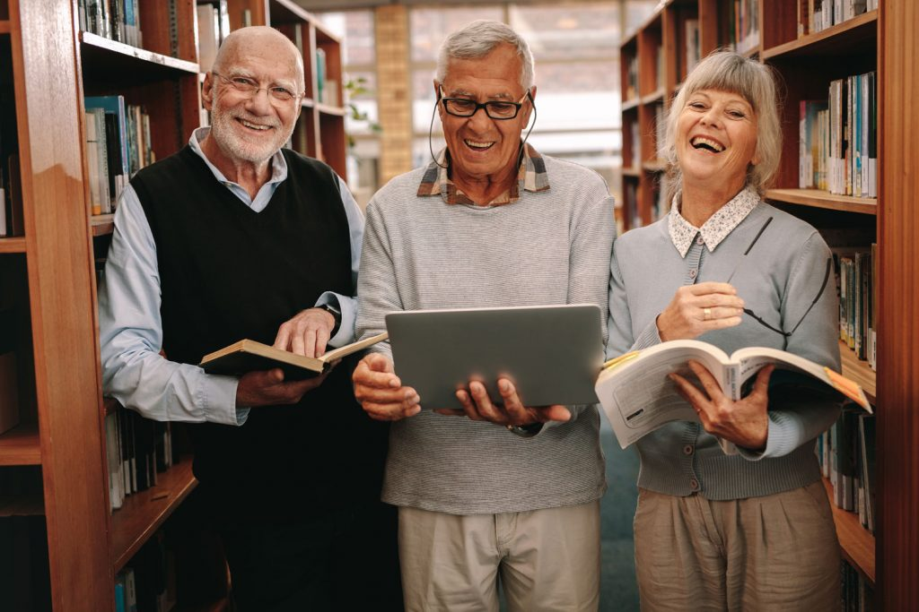 Parmer Woods at North Austin | Seniors in library
