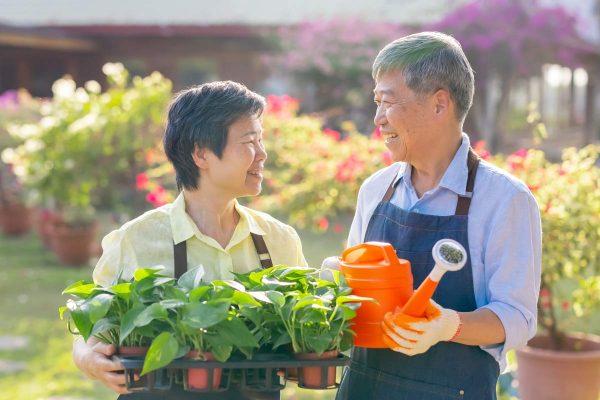 Parmer Woods at North Austin | Senior couple holding gardening equipment