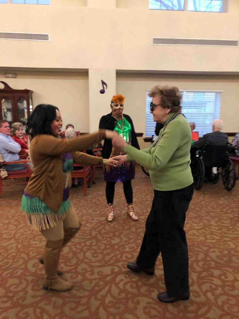 Ridgeland Place | Residents dancing with associate