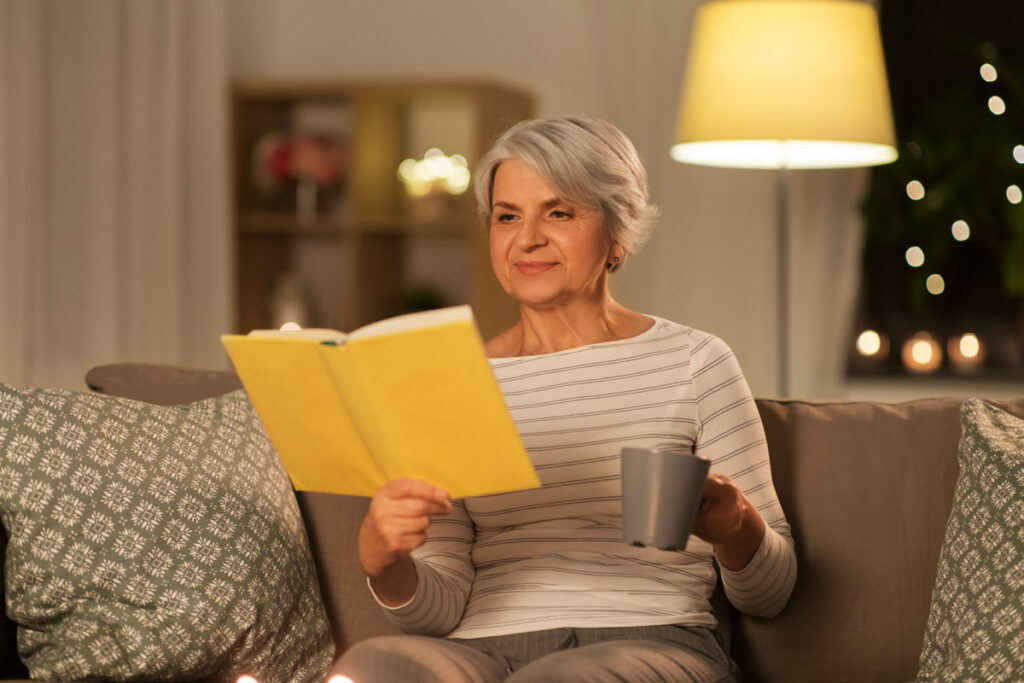 Sterling Court at Roseville | Senior woman reading at night