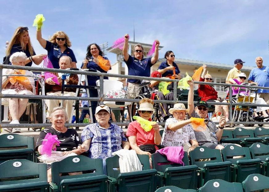 Sun City West residents at ball game in bleachers