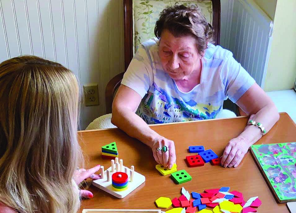 Sun City West Memory Care resident playing tabletop game