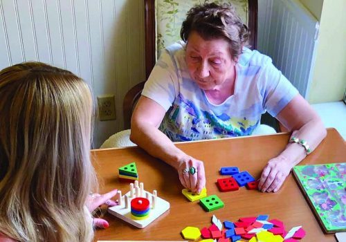 Sun City West | Memory care resident solving puzzle