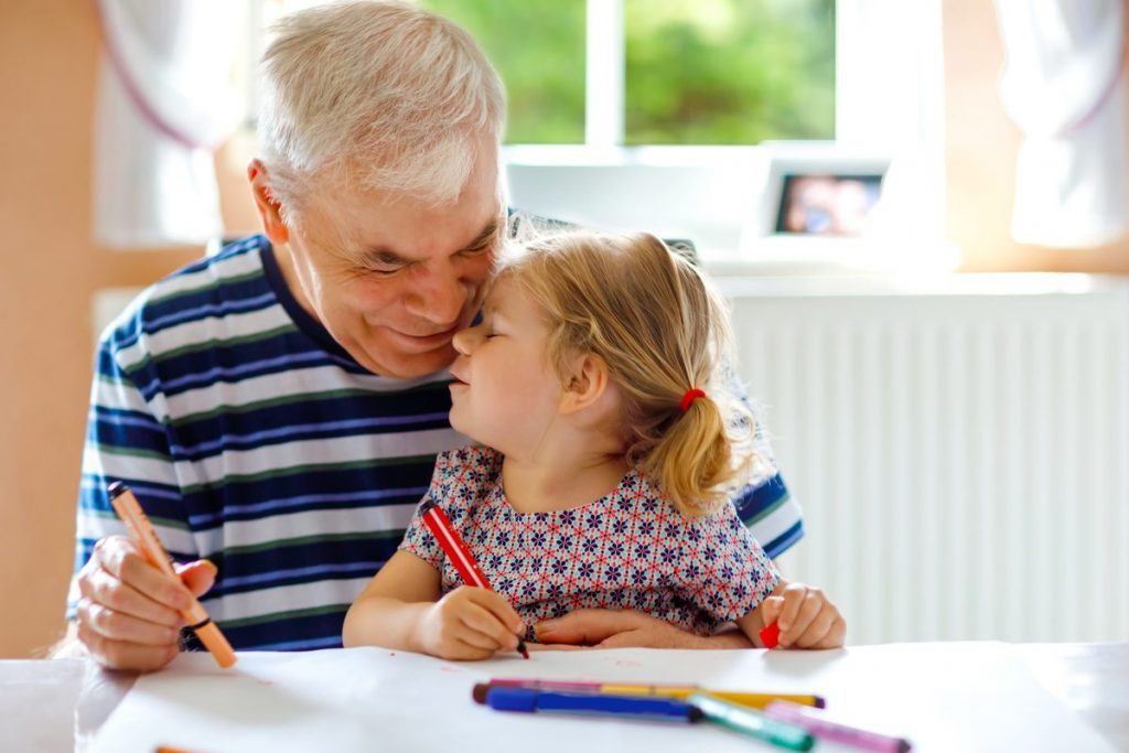grandfather and granddaughter coloring with markers