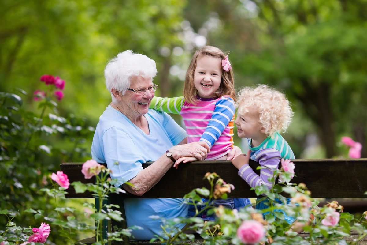 The Courtyards at Mountain View   Happy senior woman with grandchildren