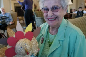 The Courtyards at Mountain View | Resident with her craft