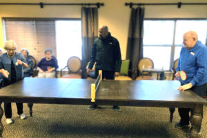 The Courtyards at Mountain View | Residents playing table tennis