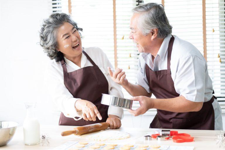 The Courtyards at Mountain View | Happy senior couple baking