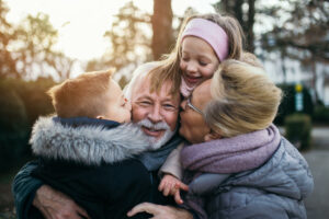 The Courtyards at Mountain View | Grandparents getting hugs from their grandkids