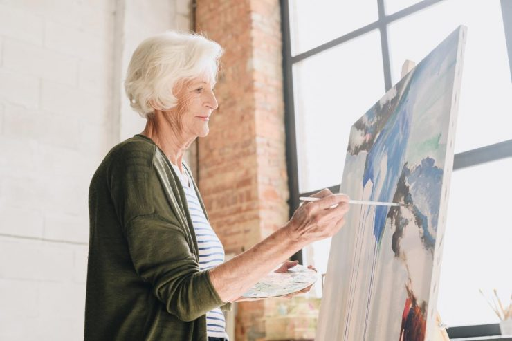 The Courtyards at Mountain View | Senior woman painting