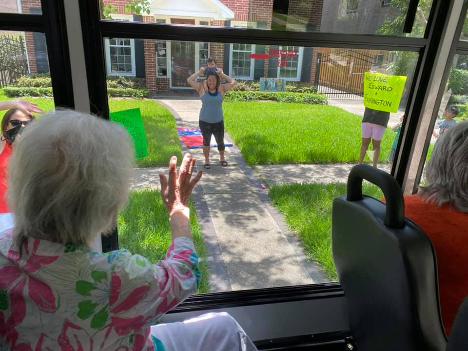The Farrington at Tanglewood | Resident waving to family from bus window