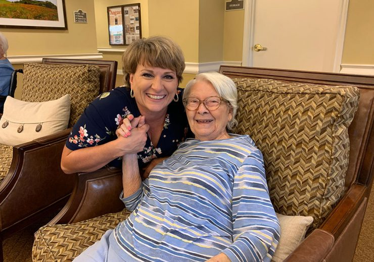 The Farrington at Tanglewood | Resident smiling with associate