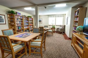 The Gardens at Marysville | Library with Reading Table