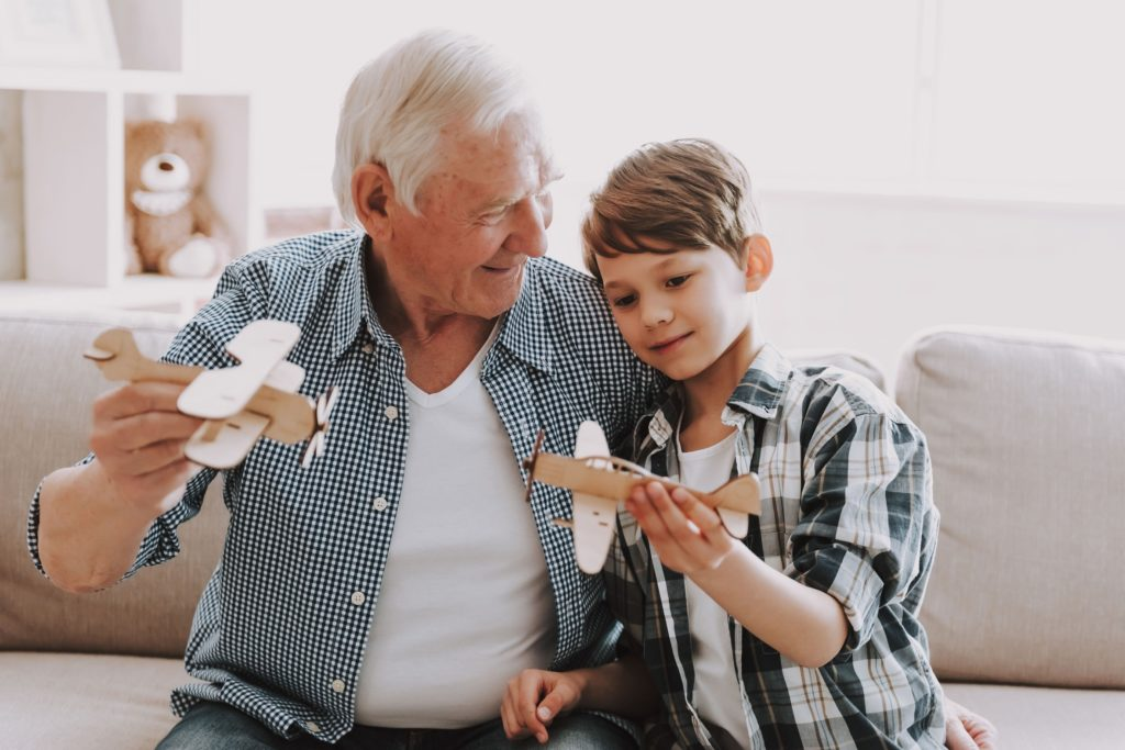 The Gardens at Marysville | Senior flying model planes with grandson