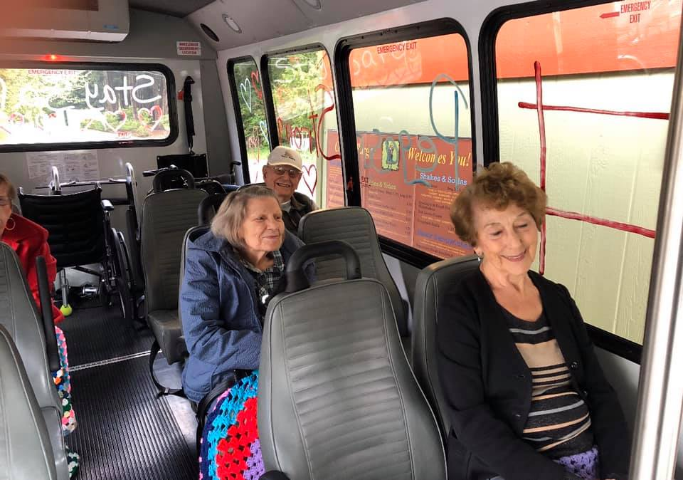 The Gardens at Marysville | Residents on bus at outing