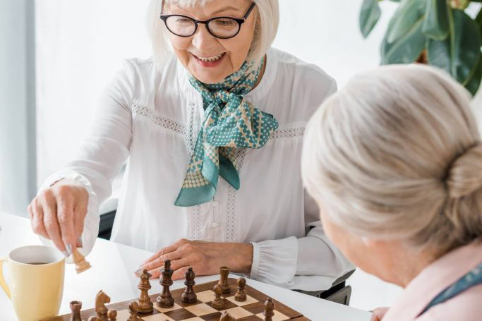 The Havens at Antelope Valley | Senior women playing chess